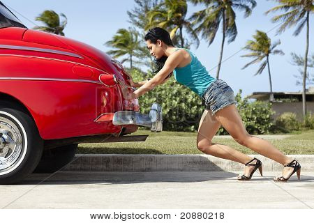 Woman Pushing Broken Down Old Car