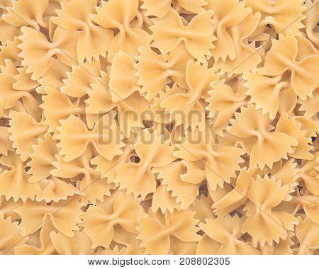 Farfalle durum semolina pasta like art texture, background