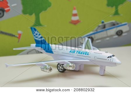 White airplane toys in the background without focus Plastic toy plane on blue copy space background for travel concept