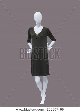 Full length female mannequin wearing black dress isolated. No brand names or copyright objects