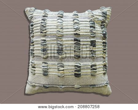 Homemade decorative cushion with knitted pattern, isolated.