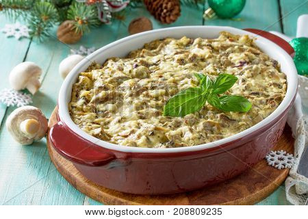 Baked Potatoes With Mushrooms And Cheese On A Festive Christmas Table.