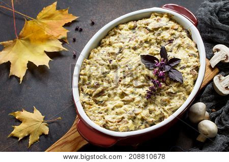 Baked Potatoes With Mushrooms, Sour Cream And Cheese On A Brown Stone Or Slate Background. Copy Spac