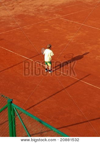 Boy On Tennis Court