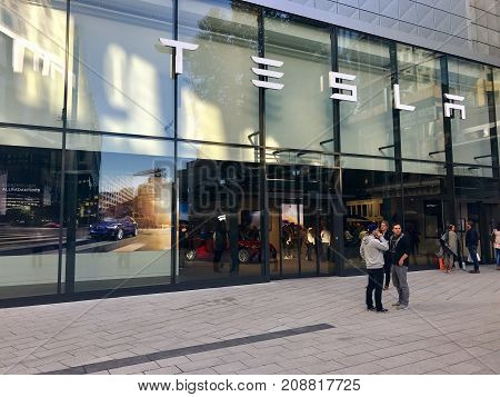 Stuttgart, Germany - October 14, 2017: People in front of the Tesla Motors showroom in Stuttgart, Germany.