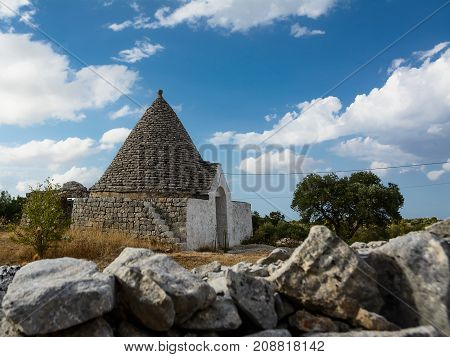 country trulli with clouds in the sky