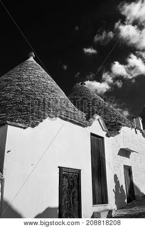 Typical Trullo of Alberobello in black and white photo