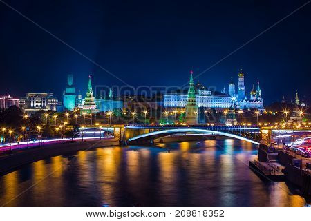 Classic Moscow night postcard the Kremlin on the river bank in front of the bridge Place for text. Big Stone Bridge, The Moscow Kremlin, Russia.