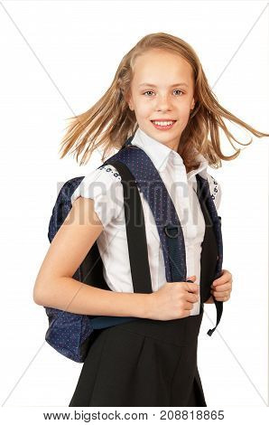 Happy schoolgirl with backpack isolated on white