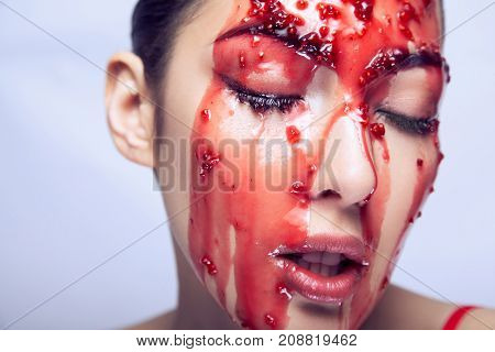 Fashion Model Showing How The Jam Flows Over Her Cheek And Enjoys It. Model Closed Eyes And Open Mou