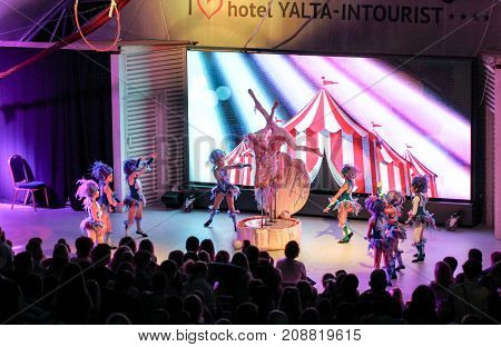 Yalta, Crimea - 11 July, The performance of teenage girls on the evening scene, 11 July, 2017. Performance of young artists on the stage of the hotel Yalta Intourist.