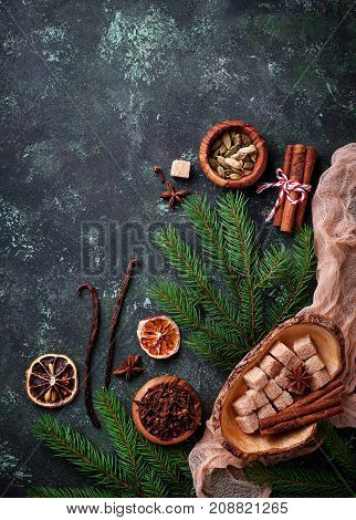 Traditional Christmas spices on green background. Top view
