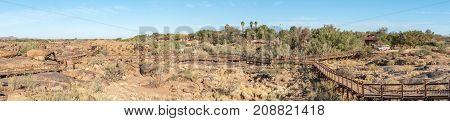 AUGRABIES FALLS NATIONAL PARK SOUTH AFRICA - JUNE 12 2017: Wheelchair-friendly trails leads to the viewpoints at the main waterfall in the Augrabies National Park in the Northern Cape Province