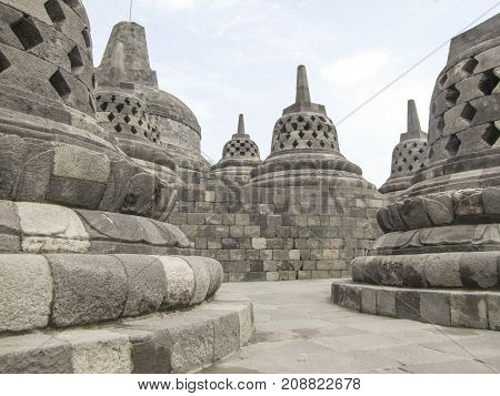 lots of stupas at a temple named Borobudur located in Java a island of Indonesia