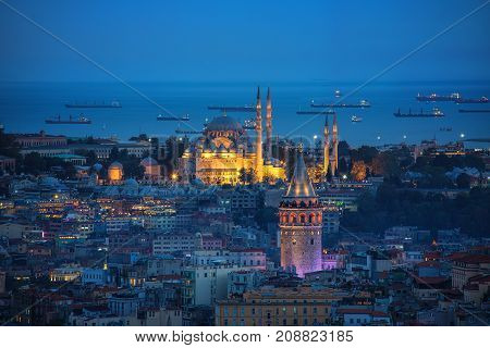 Galata Tower and Suleymaniye Mosque at evening time in Istanbul Turkey
