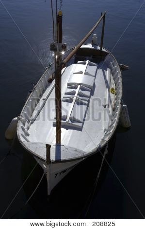 Single Wooden White Fishing Boat