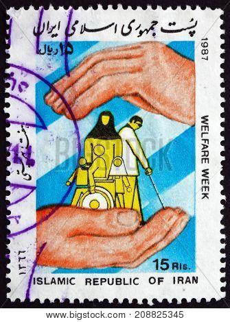 IRAN - CIRCA 1987: a stamp printed in the Iran dedicated to Welfare Week circa 1987