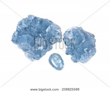 Blue celestite cluster and polished celestite palm stone isolated on white background