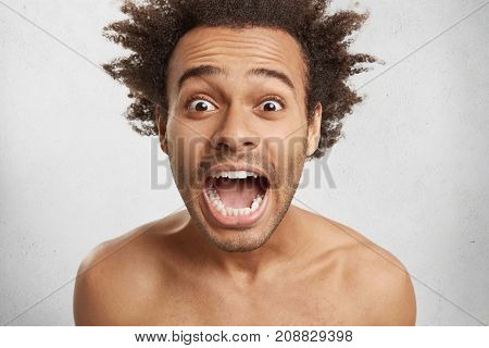Astonished Wide Eyed Afro American Customer Being Shocked With High Prices, Screams With Mouth Wide