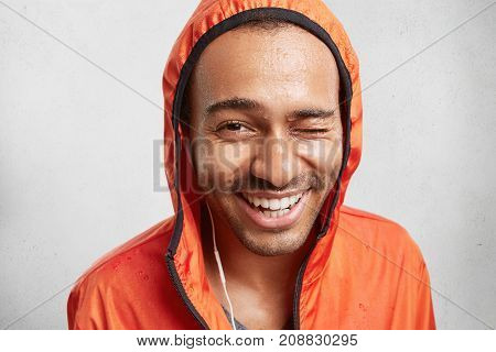 Indoor Shot Of Cheerful Positive Mixed Race Man With Healthy Pure Skin, Being Wet After Going In For