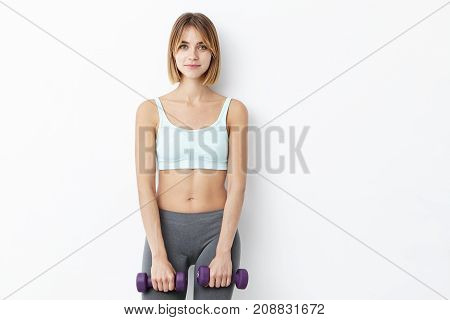 Bodybilduing And Sport Concept. Young Fit Pretty Woman With Short Hair, Dressed In Sport Clothes, Ho