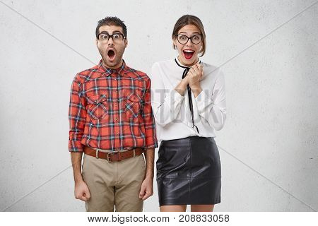 It` S Unbelievable! Shocked Man Looks Surprisedly Through Glasses, Keeps Mouth Opened, Hears Unexpec