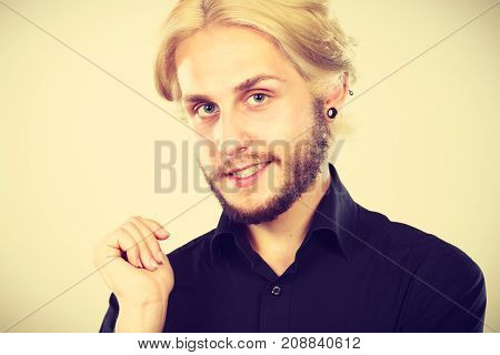 Smiling Blonde Man With Piercing