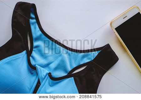 Sport bra for exercise with smartphone on white background