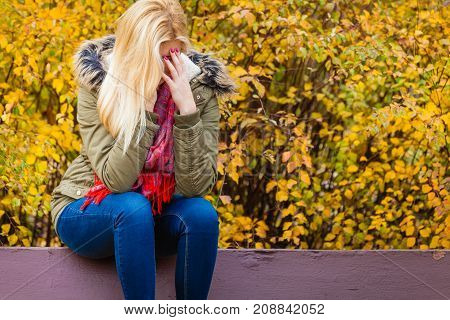 Sad Woman Sitting On Bench In Park Hiding Face