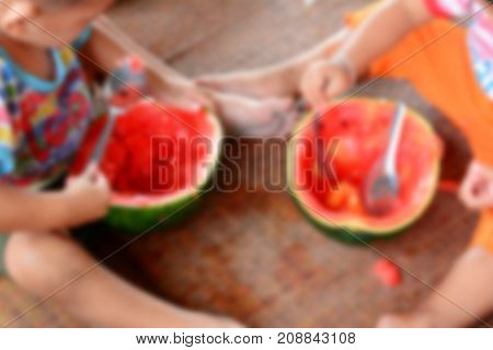 The Blurred Of The Children Eat Watermelon