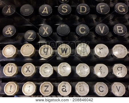 Finnish grungy old vintage typewriter including uppercase and lowercase letter A with ring, letters A and U with diaeresis, combining diaeresis, QWERTY, and ASDF keys.