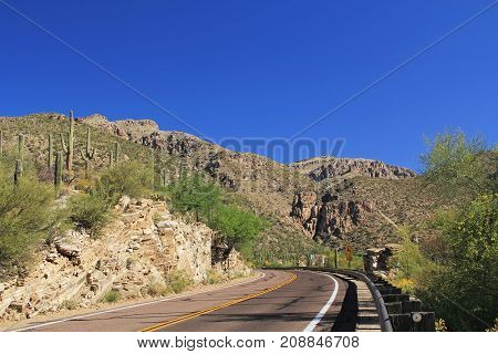 Road leading up Mount Lemmon in Tucson, Arizona, USA in the Santa Catalina Mountains located in the Coronado National Forest with blue sky copy space.