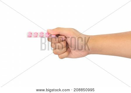 Medicine pills in hand isolated on white background