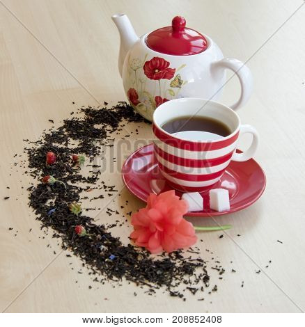 Striped Cup With Tea On A Saucer Pieces Of Sugar Cubes, Semicircular Spice, Small Wild Strawberries