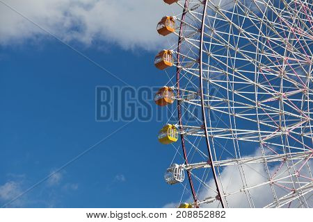 Giant funfair path of whell against blue sky background