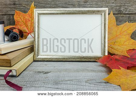 Photo Frames, Vintage Camera, Film Roll On Wooden Table With Vibrant Dry Leaves