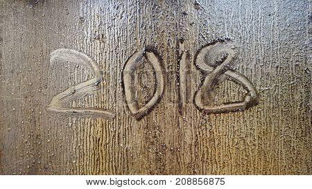 2018 written on a dirty glass. 2018 written on a dirty glass.