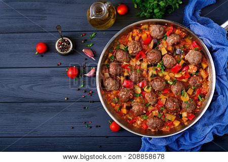Meatballs In Tomato Sauce And Vegetables In Stew-pan