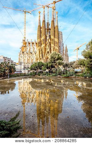 BARCELONA, SPAIN - August 17, 2017: View from the park on the famous unfinished Roman Catholic church Sagrada Familia in Barcelona, designed by Catalan architect Antoni Gaudi