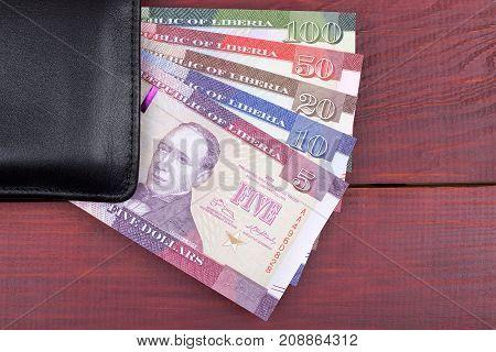 Black wallet with Liberian money - dollars