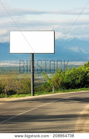 Horizontal blank billboard for outdoor advertising next to the road. Blank white mockup  poster.Template for advertising