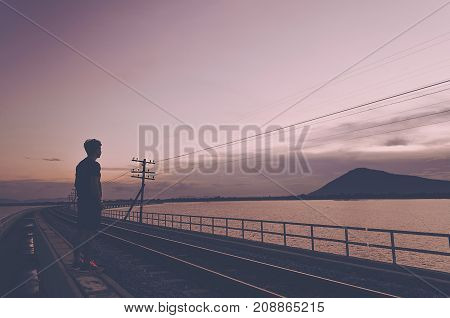 Silhouette The Lonely Man Stand on Railway See to Mountain He Miss Somebody