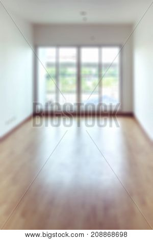 Blur Background Of Empty Condominium Interior With Separate Room And Window