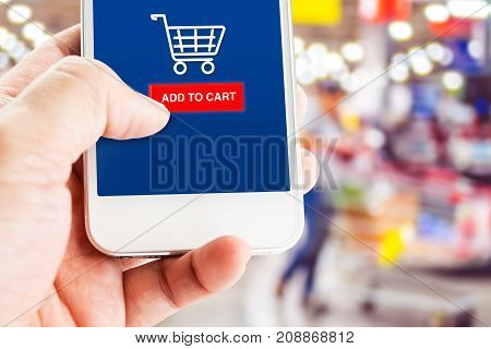 Hand Holding Mobile Phone With Blur Customer At Supermarket Store Background,shopping Online Concept