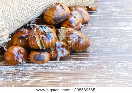 Fresh roasted chestnuts ready for eat during holiday time. Chestnut background with copy space.