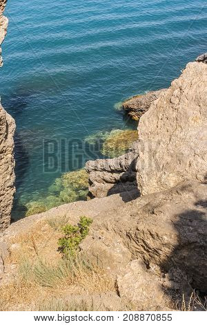 Sheer rocky coast. Travel along the coast along the path of Prince Golitsyn.