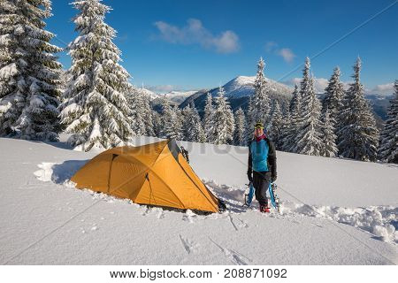 Traveler Stands In A Deep Snow Near A Tent