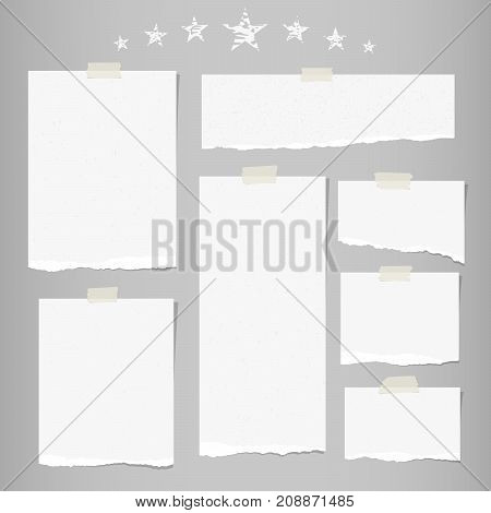 White ripped note, notebook paper for message or text stuck with sticky tape on gray background with stars