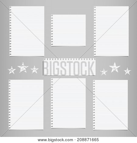 White striped note, notebook paper for message or text stuck on gray background with stars