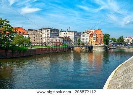 Wroclaw/Poland- August 18, 2017: cityscape with river Odra, street with old historical and modern buildings, bridge and blue sky, sunny  summer day